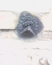 Репер (1988) на будинку № 6 по вул. Максима Берлинського, м. Київ