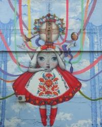 Кукла на стене