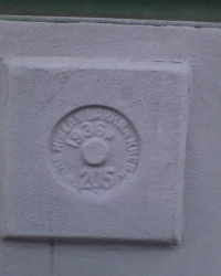 Нивелирная марка (205) 1936 года, ул. М. Грушевского, 30